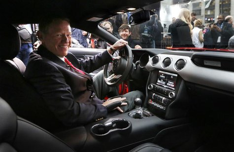 Ford Motor Co. CEO Alan Mulally sits in the driver seat of its all new 2015 Ford Mustang on ABC's Good Morning America in New York December