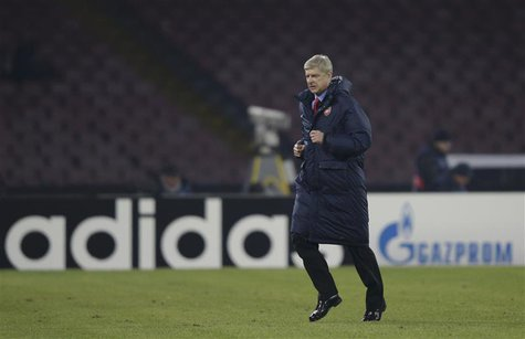 Arsenal's Coach Arsene Wenger leaves the pich at the half-time of the the Champions League soccer match against Naples at San Paolo stadium