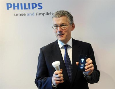 Philips Electronics Chief Executive Frans van Houten shows a LED bulb which can be controlled directly from an iOS or Android device, during