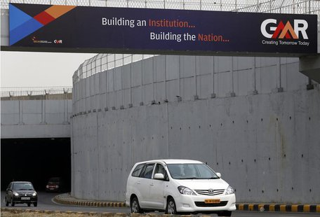 Vehicles cross through an underpass constructed by GMR Infrastructure that connects to the airport in New Delhi, May 13, 2013. REUTERS/Anind