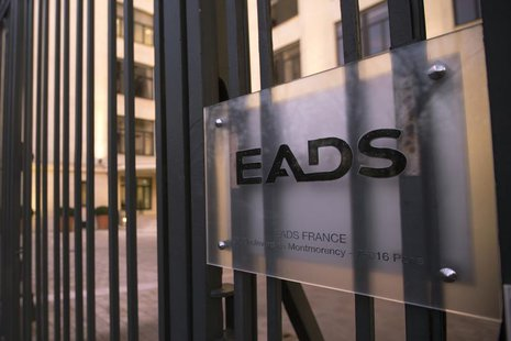 A sign is seen on the entrance gate of the main Paris office building of EADS, December 9, 2013. REUTERS/Philippe Wojazer