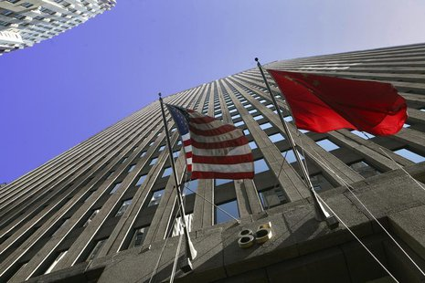 The flags of the U.S. and China hang outside of 85 Broad Street, headquarters for the investment bank Goldman Sachs in New York, October 23,