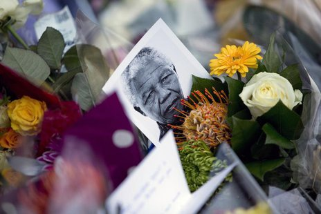 Tributes for former President Nelson Mandela are seen at the South African High Commission in London December 6, 2013. REUTERS/Neil Hall