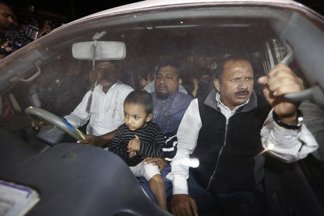 Relatives of Islamist leader Abdul Quader Mollah seated in a vehicle come out of Dhaka Central Jail after meeting him in Dhaka December 10,