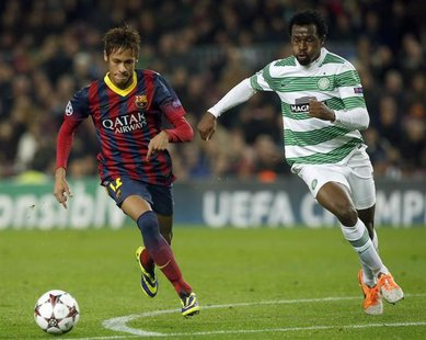 Barcelona's Neymar (L) and Celtic's Efe Ambrose challenge for the ball during their Champions League soccer match at Camp Nou stadium in Bar