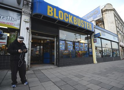 A man stands outside a Blockbuster shop in south London January 16, 2013. REUTERS/Paul Hackett