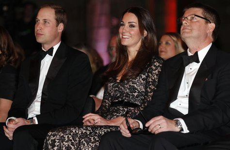 Britain's Prince William (L-R) and his wife Catherine, the Duchess of Cambridge, sit with Natural History Museum Director Michael Dixon befo
