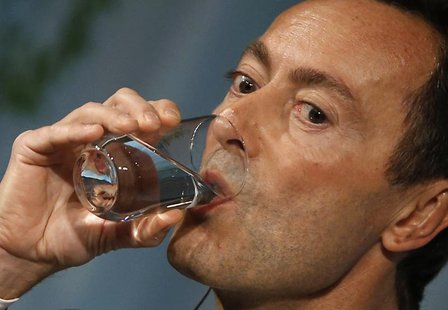 Airbus President and Chief Executive Officer Fabrice Bregier drinks water as he delivers a speech at the Global Management Forum in Tokyo Oc