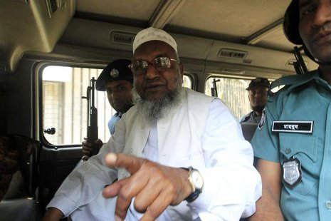 Bangladesh's Jamaat-e-Islami leader Abdul Quader Mollah gestures as he talks from a police van after a war crimes tribunal sentenced him to