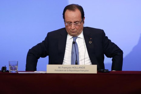 France's President Francois Hollande attends a news conference at the Elysee Palace at the end of the Elysee Summit for Peace and Security i
