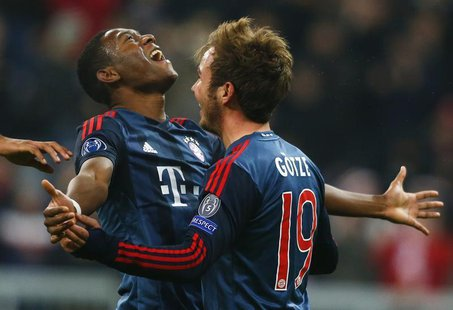 Bayern Munich's Mario Goetze (R) celebrates with David Alaba after scoring a goal against Manchester City during their Champions League Grou