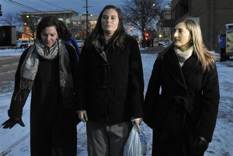 Jordan Graham (C), accompanied by members of her legal team, walks away from U.S. District Court in Missoula, Montana on December 11, 2013.