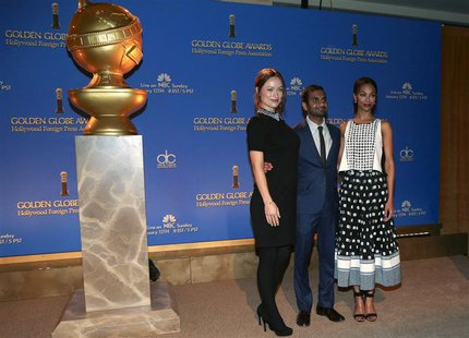 (L-R) Actors Olivia Wilde, Aziz Ansari and Zoe Saldana pose at the announcement of nominations for the 71st annual Golden Globe Awards in Be