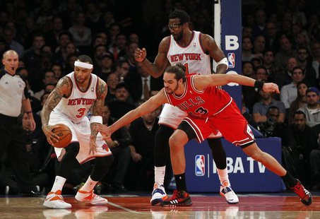 Dec 11, 2013; New York, NY, USA; New York Knicks power forward Kenyon Martin (3) grabs a loose ball away from Chicago Bulls center Joakim No
