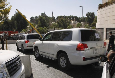United Nations (U.N.) vehicles transporting a team of experts from the Organisation for the Prohibition of Chemical Weapons (OPCW), leave th