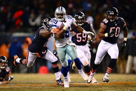 Dec 9, 2013; Chicago, IL, USA; Dallas Cowboys running back DeMarco Murray (29) runs the ball during the fourth quarter against the Chicago B