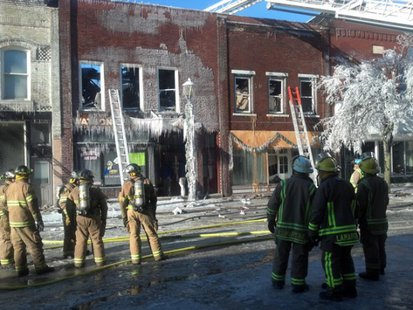 With hot spots continuing to flare up, firefighters stand by to help the damage in downtown Ripon. (Photo from: FOX 11)
