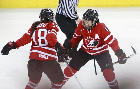 Canada's Caroline Ouellette (R) celebrates her goal with team mate Catherine Ward during the second period of their gold medal game against