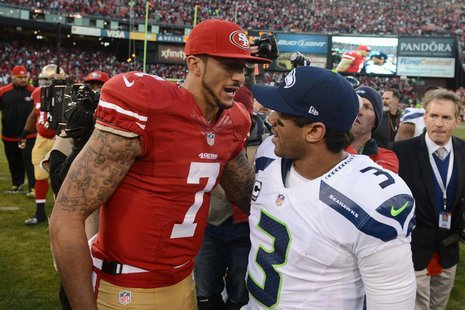 San Francisco 49ers quarterback Colin Kaepernick (7) shakes hands with Seattle Seahawks quarterback Russell Wilson (3) after the game at Can