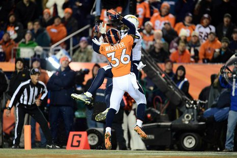 Dec 12, 2013; Denver, CO, USA; San Diego Chargers wide receiver Keenan Allen (13) scores his second touchdown in front of Denver Broncos cor