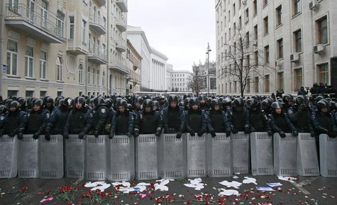 Riot police and Interior Ministry personnel block a street during a rally organized by supporters of EU integration in central Kiev, Decembe
