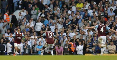 West Ham United's Ravel Morrison (L) celebrates with team mate Ricardo Vaz Te after scoring against Tottenham Hotspur during their English P