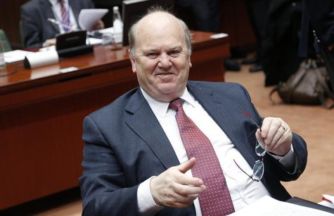 Ireland's Finance Minister Michael Noonan smiles at the start of a European Union finance ministers meeting in Brussels December 10, 2013. R