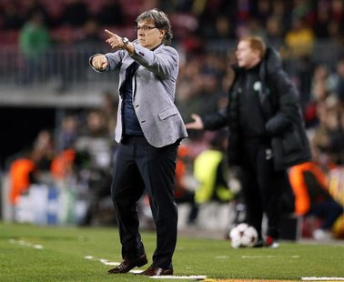 "Barcelona's coach Gerardo ""Tata"" Martino gives instructions during their Champions League soccer match against Celtic at Camp Nou stadium in"