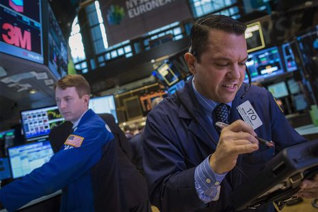 Trader Michael Zicchinolfi works on the floor of the New York Stock Exchange December 11, 2013. REUTERS/Brendan McDermid