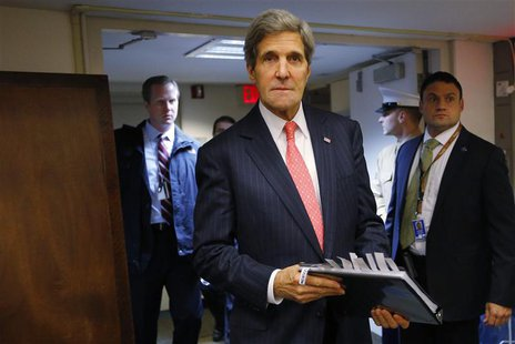 U.S. Secretary of State John Kerry enters the room for a news conference at the U.S. Embassy in Tel Aviv December 13, 2013. REUTERS/Brian Sn