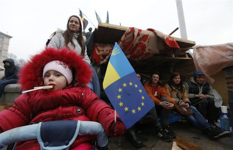 A child holds a flag during a rally held by Pro-European integration protestors in Independence Square in central Kiev, December 13, 2013. R