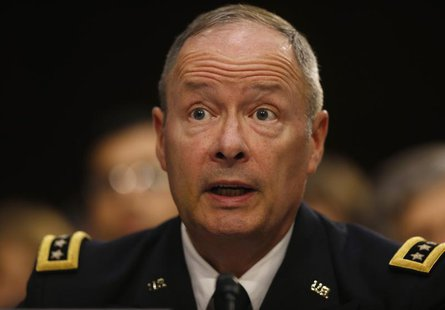 U.S. National Security Agency Director General Keith Alexander testifies at a Senate Intelligence Committee hearing the Foreign Intelligence
