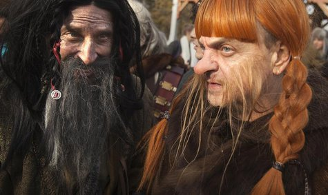 "People dressed up as dwarves film a promotional video for the ""The Hobbit: The Desolation of Smaug"" at Belvedere Castle in Central Park, New"