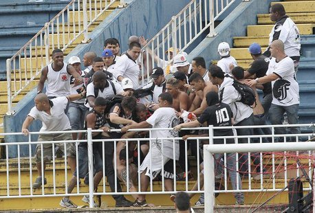 Vasco da Gama soccer fans beat up an Atletico Paranaense fan during their Brazilian championship match in Joinville in Santa Catarina state