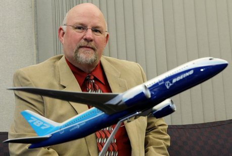 Aerospace Machinist Industrial District Lodge 751 president Tom Wroblewski sits behind a model of the Boeing 787 Dreamliner jet at his union