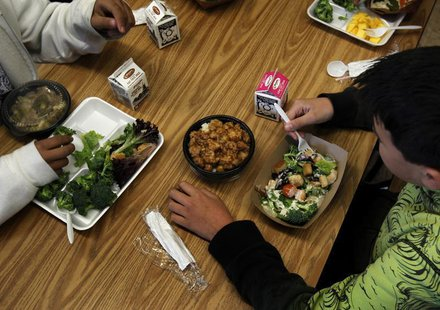 Students eat a healthy lunch at Marston Middle School in San Diego, California, March 7, 2011. REUTERS/Mike Blake