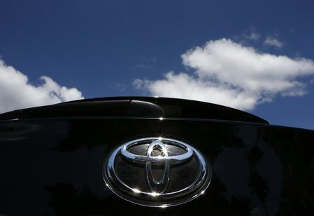 The Toyota logo is seen on a car in Los Angeles October 10, 2012. REUTERS/Lucy Nicholson