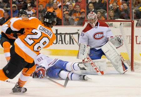 Philadelphia Flyers center Claude Giroux (28) scores against Montreal Canadiens goalie Carey Price (31) during the second period at Wells Fa