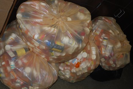 Empty plastic medicine containers wait to be recycled after drugs were properly disposed