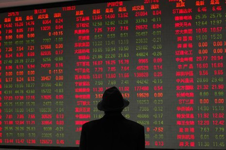 A man looks at an electronic board at a brokerage house in Shanghai April 6, 2011. REUTERS/Aly Song