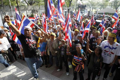 Anti-government protesters hold Thai national flags during a public seminar where protest leader and former deputy prime minister Suthep Tha