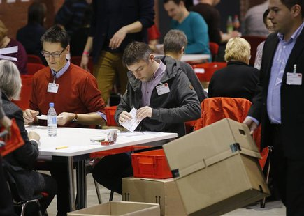 "Volunteers of the Social Democratic Party count the ballots of the ""Member Vote"" for a new ""grand coalition"" between the Social Democratic P"
