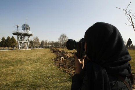 A photojournalist takes pictures at the Iranian Space Agency (ISA) in Mahdasht, about 60 km (37 miles) west of Tehran, February 29, 2012. RE