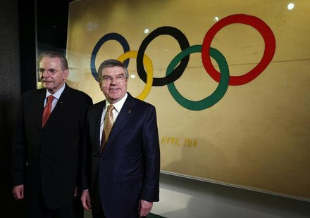 International Olympic Committee (IOC) President Thomas Bach (R) poses with his predecessor Jacques Rogge in a new presentation room at the O