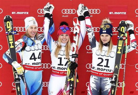First placed Tina Weirather of Liechtenstein (C), second placed Kajsa Kling of Sweden (L) and third placed Anna Fenninger of Austria pose on