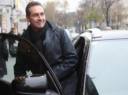 Head of the Austrian Freedom Party (FPOe) Heinz-Christian Strache enters his car after leaving a meeting with fellow European right-wing pol