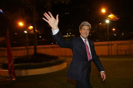U.S. Secretary of State John Kerry waves to the crowd after greeting staff at the U.S. Consulate in Ho Chi Minh City December 14, 2013. REUT