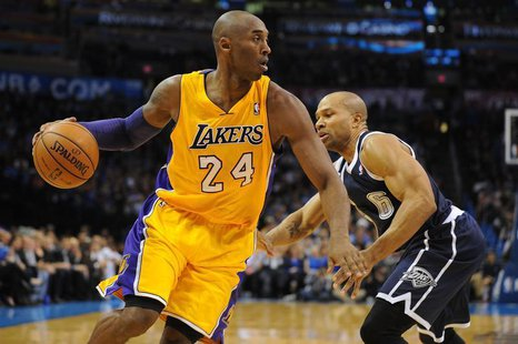Dec 13, 2013; Oklahoma City, OK, USA; Los Angeles Lakers shooting guard Kobe Bryant (24) dribbles the ball around Oklahoma City Thunder poin