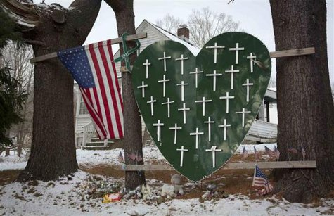 A heart is emblazoned with crosses to commemorate the 26 Sandy Hook Elementary School shooting victims in Sandy Hook village in Newtown, Connecticut December 13, 2013. Credit: Reuters/Carlo Allegri