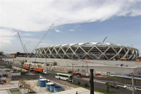 The Arena Amazonia stadium is under construction to host several 2014 World Cup soccer games, in Manaus December 14, 2013. Construction work